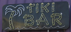 the sign for the Boardwalk Tiki Bar